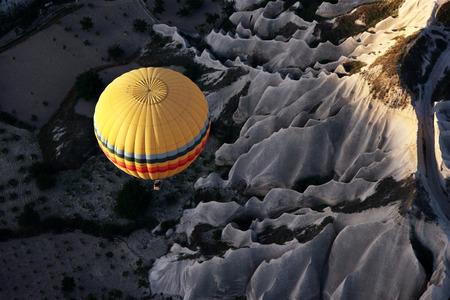 spectacular: A hot air balloon flies above the spectacular Cappadocia landscape near Goreme in Turkey at sunrise.