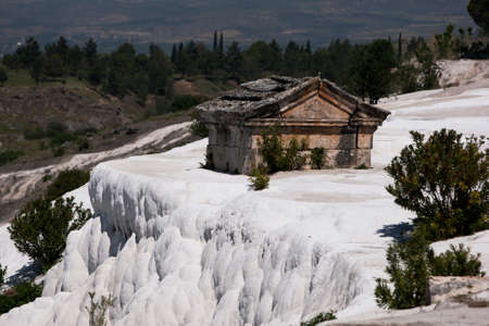 hierapolis: A tomb in the necropolis cemetery at the ancient city of Hierapolis which has been engulfed by the travertines. Stock Photo