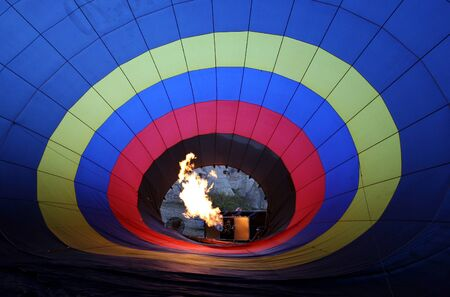 inflate: A photo taken from inside a hot air balloon as it is heated to inflate the canopy ready for lift-off. Stock Photo