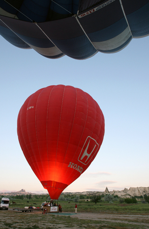 propane: The interior of the red hot air balloon glows as the propane burners are fired by the pilot. Editorial