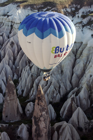 spectacular: A hot air balloon navigates it way down the spectacular Rose Valley at sunrise, near Goreme in the Cappadocia region of Turkey.