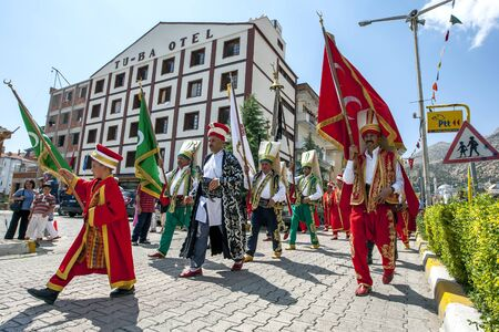 ceremonial: A ceremonial parade takes place down the main street of Elmail prior to the commencement of the Elmali Turkish Oil Wrestling Festival in Turkey.
