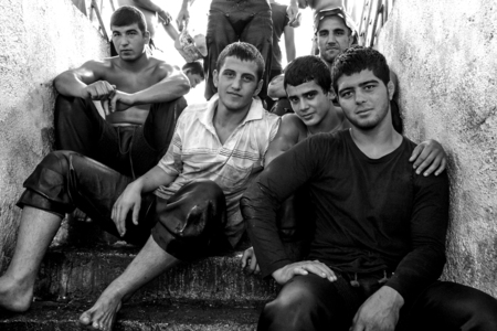 wrestlers: Wrestlers relax on the entrance stairs after competing at the Elmali Turkish Oil Wrestling Festival in Elmali, Turkey.