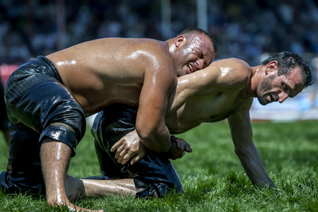 heavy weight: Heavy weight wrestlers battle for supremecy at the Elmali Turkish Oil Wrestling Festival in Turkey. Editorial