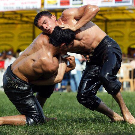 supremacy: Wrestlers battle for supremacy at the Velimese Turkish Oil Wrestling Festival, Turkey, 2010.