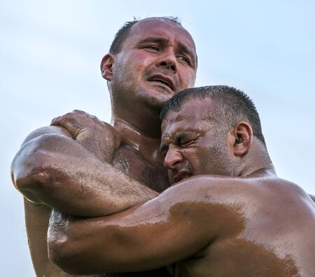 heavy weight: Heavy weight wrestlers battle for victory at the Velimese Turkish Oil Wrestling Festival in Turkey.