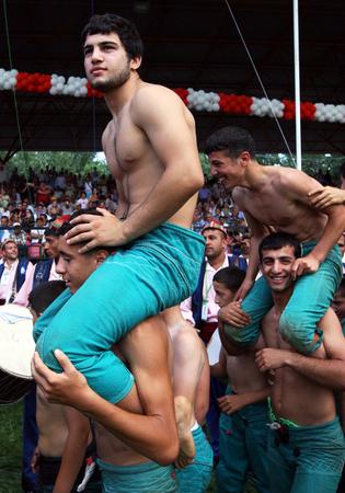 wrestlers: Wrestlers enjoy the parade around the famous Kirkpinar arena prior to competition starting, Edirne, Turkey, 2009.