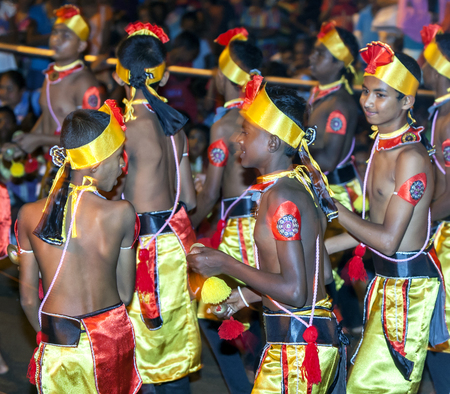 cymbal: Cymbal Players perform along the streets of Kandy during the Esal Perahara. Sri Lanka.
