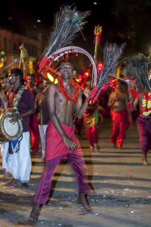 Kavadi Dancers with hooks piercing their bodies moves through the streets of Kandy during the Esala Perahera in Sri Lanka. The Kavadi Dancers are of Hindu faith but are still welcomed to perform during the Buddhist festival. The Esala Perahera Festival ru Editorial