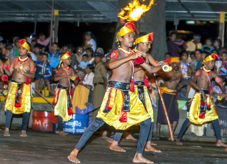 cymbal: Cymbal Players, otherwise known as Thalampotakaruwo, perform in front of large crowds in Kandy during the Esala Perahera. The Esala Perahera festival runs every year in late July or early August for ten days, ending on the Nikini poya full moon and is hel Editorial