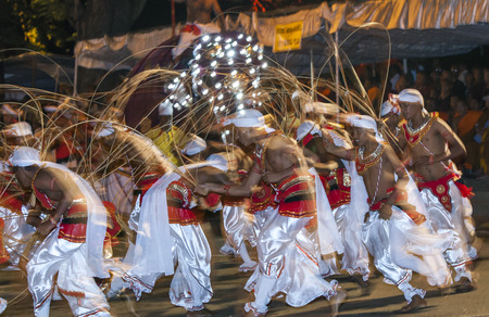 exhilarating: Ratten Weavers perform in the Esala Perahara in Kandy, Sri Lanka. This is one of the most exhilarating dances to witness as the performers rush around in a circular motion whilst moving their rattens up and down to imitate weaving baskets.