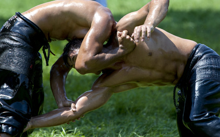 the superiority: Wrestlers battle for superiority at the Kirkpinar Turkish Oil Wrestling Festival, Edirne, Turkey. Editorial