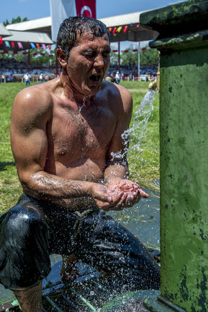 edirne: A wrestler cools off under the water fountains after competing in hot conditions at the Kirkpinar Turkish Oil Wrestling Festival in Edirne in Turkey.