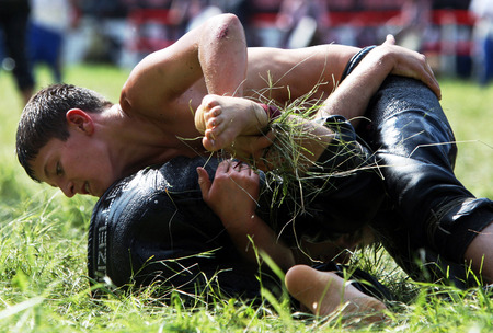 wrestlers: Young wrestlers engage in battle at the Kirkpinar Turkish Oil Wrestling Festival in Edirne, Turkey