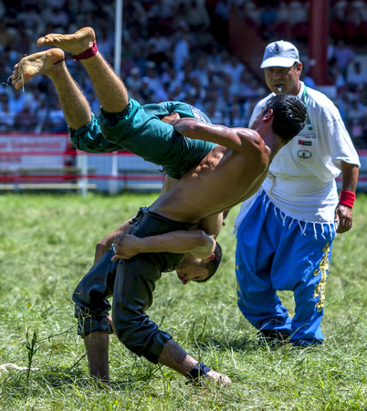 edirne: A wrestler is lifted skywards during competition at the Kirkpinar Turkish Oil Wrestling Festival in Edirne in Turkey.