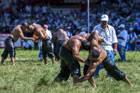 the heavyweight: Heavyweight wrestlers battle for victory in the arena at the Kirkpinar Turkish Oil Wrestling Festival in Edirne, Turkey.