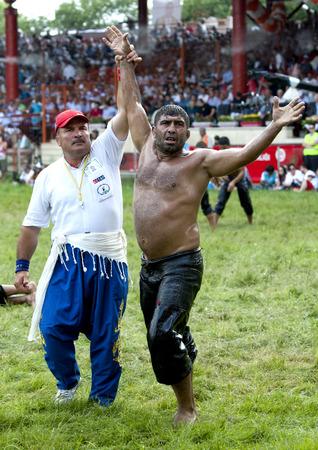 edirne: A wrestler is awarded victory at the Kirkpinar Turkish Oil Wrestling Festival in Edirne, Turkey.