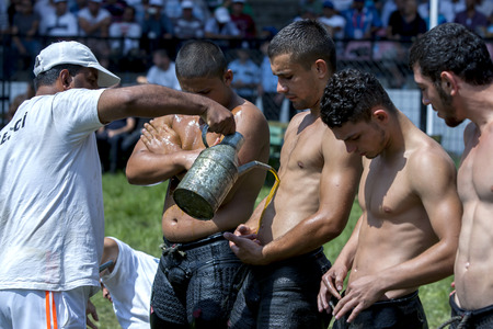 wrestlers: Wrestlers  have olive oil applied to their bodies prior to competition starting at the Kirkpinar Turkish Oil Wrestling Festival in Edirne, Turkey.