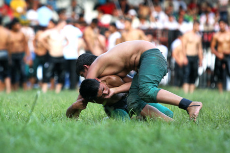 wrestlers: Young wrestlers fight for victory at the Kirkpinar Turkish Oil Wrestling Festival in Edirne in Turkey.
