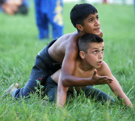 edirne: Young wrestlers question a referee at the Kirkpinar Turkish Oil Wrestling Festival in Edirne in Turkey. Editorial