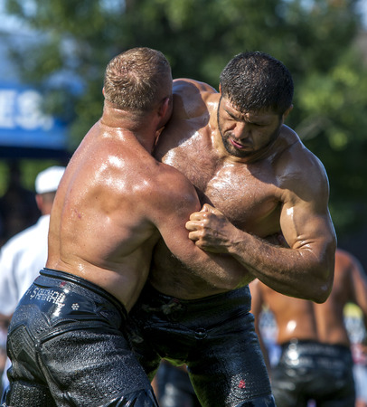 heavy weight: Heavy weight wrestlers fight for victory at the Kagithane in Istanbul in Turkey.