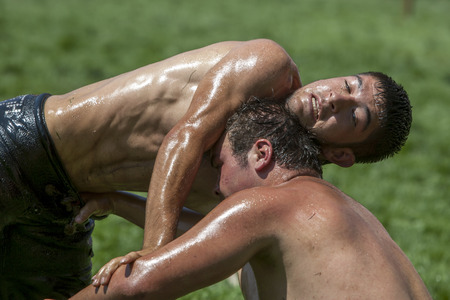 wrestlers: Wrestlers battle for victory at the Elmali Turkish Oil Wrestling Festival in Turkey.