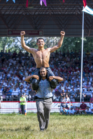 edirne: A wrestler celebrates victory in his division of competition at the Kirkpinar Turkish Oil Wrestling Festival in Edirne, Turkey. Kirkpinar is considered the most prestigous wrestling event in Turkey to win.