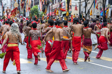 kavadi: Kavadi Dancers with hooks piercing their bodies move through the streets of Kandy during the Day Perahera in Sri Lanka. Although Kavadi Dancers are Hindu they are welcome to perform in the Buddhist perahera. The Esala Perahera Festival runs every year in