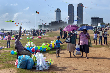 galle: Vicitors to Galle Face Green enjoy a sunny afternoon as a toy seller tries to entice customers. Colombo, Sri Lanka.