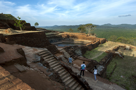 brick work: The summit of Sigiriya Rock showing the ancient brick work and water storage tank (centre). Sri Lanka.