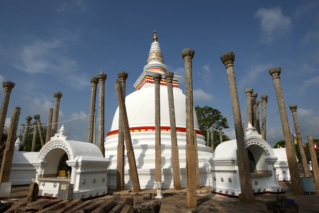 dagoba: The Thuparama Dagoba at Anuradhapura is the oldest dagoba in Sri Lanka. It was constructed by Devanampiya Tissa in the 3rd Century BC and is surrounded by 41 ancient pillars. Stock Photo