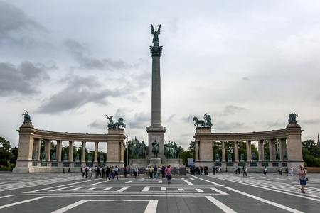 heros: Tourists gather in front of the Millennium Monument in Heros Square in Budapest in Hungary. Construction of the Millennium Monument began in 1896 to commemorate the 1000th anniversary of the Hungarian conquest of the Carpathian Basin. Editorial