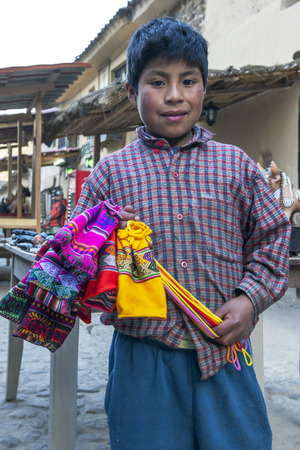 sacred valley: A young salesman at the market in Ollantaytambo which sits in the Sacred Valley of the Incas in Peru.