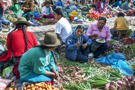 sacred valley of the incas: Fruit and vegetable sellers at the market in Pisac located in the Sacred Valley of the Incas in Peru.