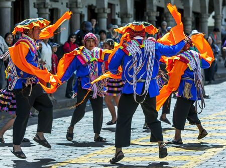 plaza de armas: Colourfully dressed performers dance at Plaza de Armas in Cusco during the May Day parade in  Peru.