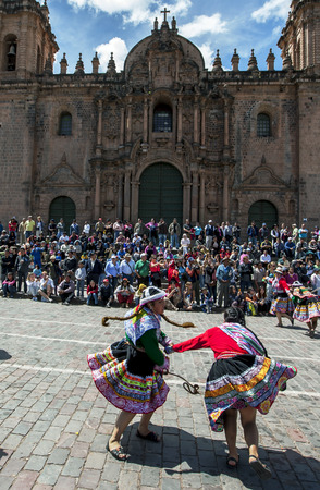 colourfully: Colourfully dressed performers dance in front of the Cathedral of Cusco  at Plaza de Armas in Cusco during the May Day parade in  Peru.