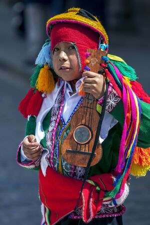 colourfully: A colourfully dressed boy performs at the Plaza de Armas in Cusco during the May Day parade in  Peru.