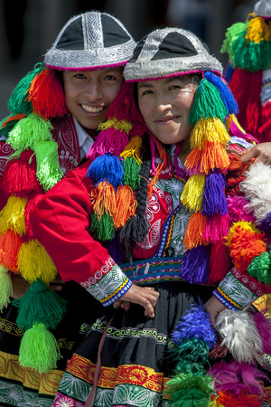 colourfully: Colourfully dressed performers pose for a photograph at Plaza de Armas in Cusco during the May Day parade in  Peru. Editorial