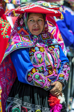 colourfully: A colourfully dressed lady poses for a phototgraph at Plaza de Armas in Cusco during the May Day parade in  Peru.