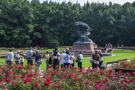chopin: Visitors to Lazienki Park in Warsaw, Poland admire the Chopin Monument.