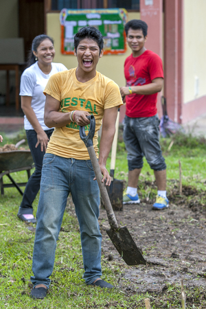 indiana: Peruvian university students happy to be doing some gardening at the school in the Amazon River town of Indiana, Peru.