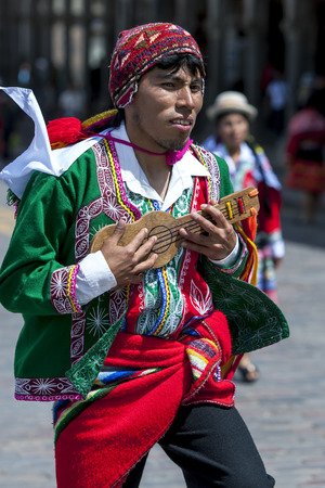 colourfully: A colourfully dressed musician in Peruvian costume performs at Plaza de Armas in Cusco during the May Day parade in Peru. Editorial