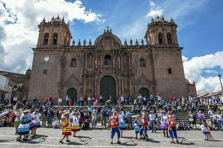 plaza de armas: Colourfully dressed performers dance past the Cathedral of Cusco at Plaza de Armas in Cusco during the May Day parade in  Peru. Editorial