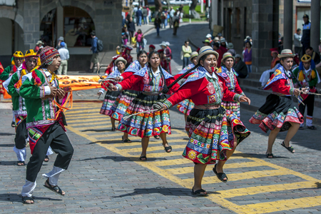 plaza de armas: Dancers and musicians dressed in Peruvian costume perform at Plaza de Armas during the May Day parade in Cusco, Peru.