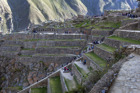 15th century: Visitors to Ollantaytambo climb over the terraces at the ancient site in the Sacred Valley of the Incas in Peru. Ollantaytambo was constructed by Incan Emperor Pachacuti as part of his royal estate in the mid 15th century. This is one of the most spectacu
