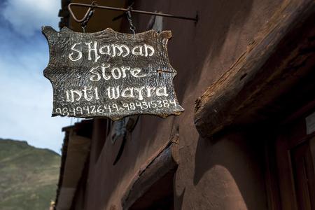 pisac: An unusual sign outside a Shaman store in Pisac, Peru.