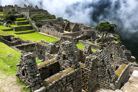 metres: The incredible ancient ruins of Machu Picchu in Peru showing the residential section in the foreground. Machu Picchu is a 15th-century Inca site located 2,430 metres (7,970 ft) above sea level and is situated on a mountain ridge above the Sacred Valley wh