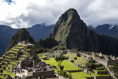 sacred valley: The incredible ancient ruins of Machu Picchu in Peru. Machu Picchu is a 15th-century Inca site located 2,430 metres (7,970 ft) above sea level and is situated on a mountain ridge above the Sacred Valley which is 80 kilometres northwest of Cusco and throug