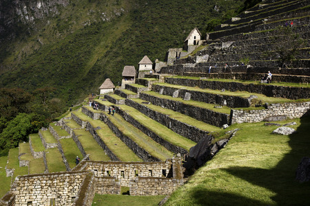 metres: A section of rock terraces at the incredible ancient ruins of Machu Picchu in Peru. Machu Picchu is a 15th-century Inca site located 2,430 metres (7,970 ft) above sea level and is situated on a mountain ridge above the Sacred Valley which is 80 kilometres Stock Photo