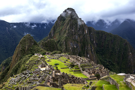 kilometres: The incredible ancient ruins of Machu Picchu in Peru. Machu Picchu is a 15th-century Inca site located 2,430 metres (7,970 ft) above sea level and is situated on a mountain ridge above the Sacred Valley which is 80 kilometres northwest of Cusco and throug